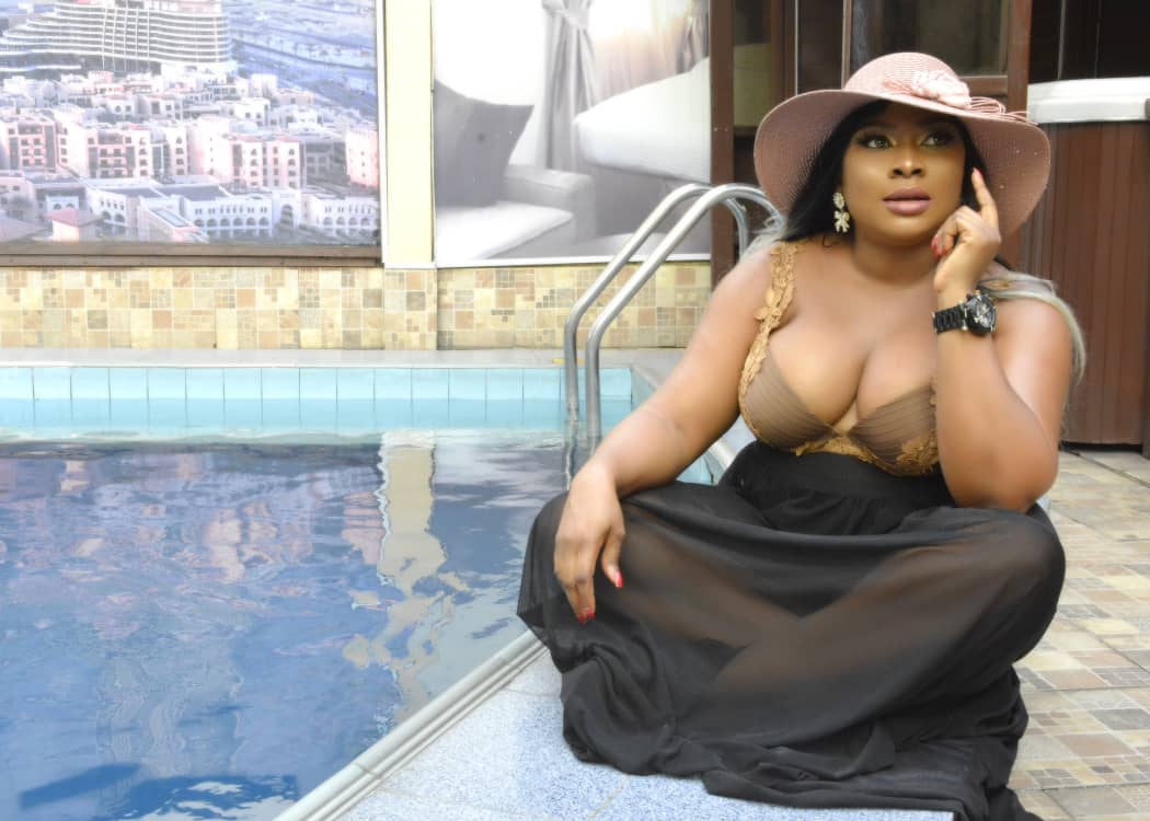 Nigerian fashion model/Actress Queeneth Agbor Flashes heavy cleavage in new birthday shoot.